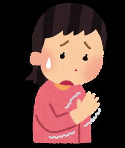 手が痺れている女性