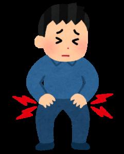 股関節を痛がる男性